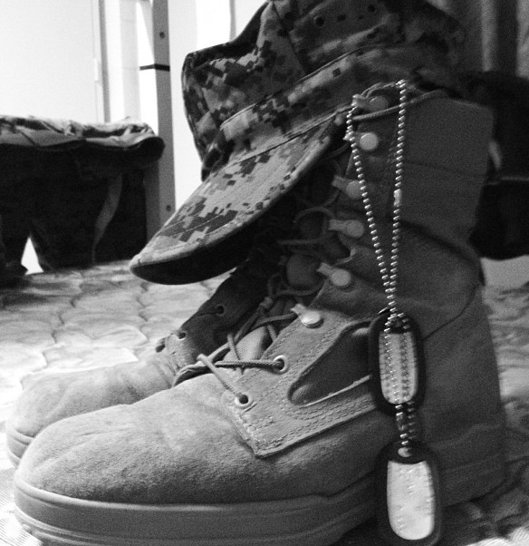 military combat boots and dog tags