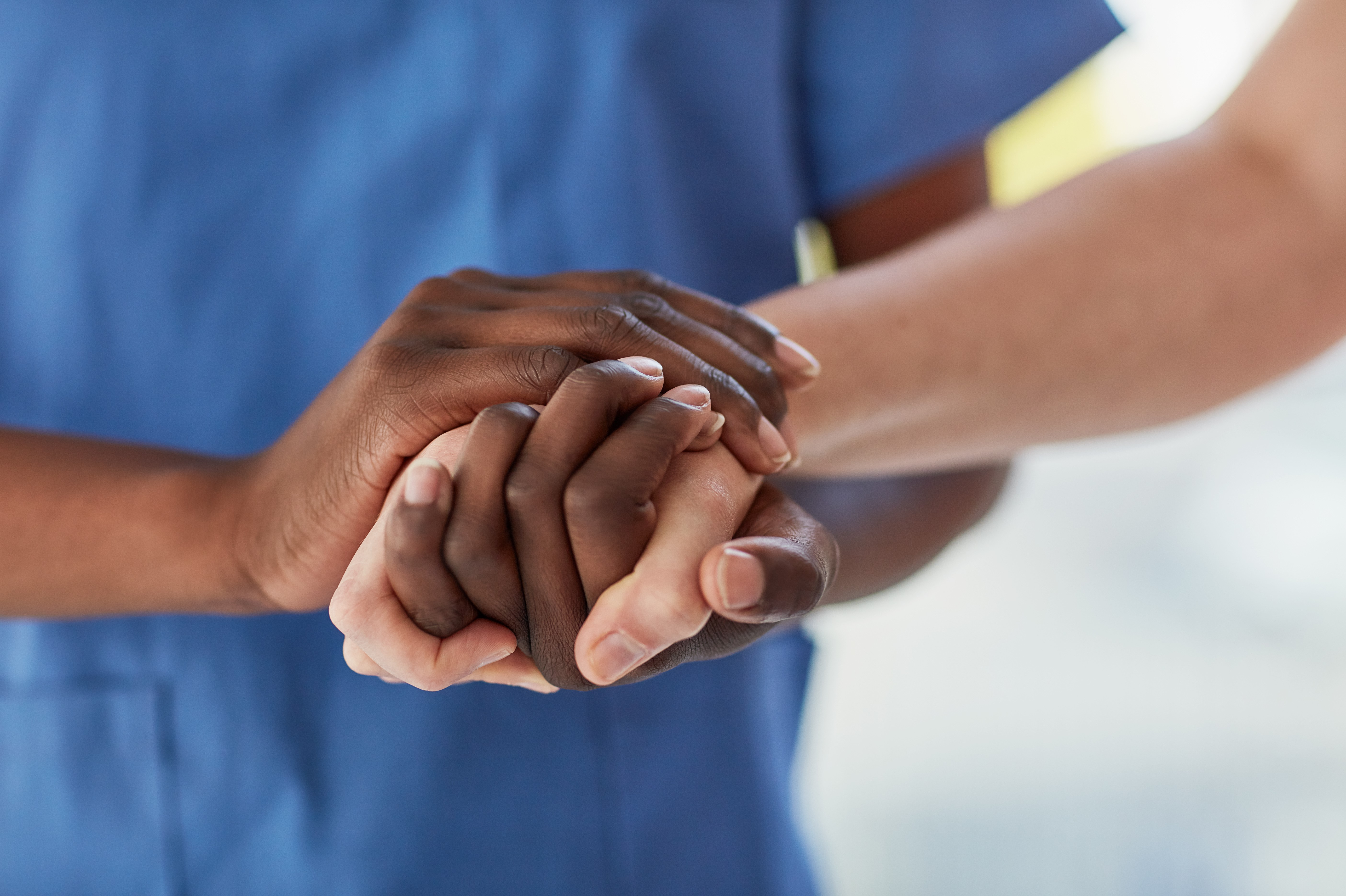 healthcare provider holding patient hands