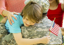 child hugging soldier
